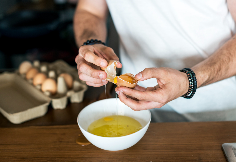 closeup-of-man-separating-egg-yolk